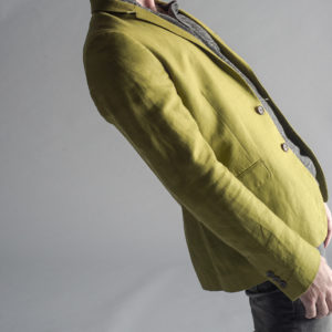 Man-In-Green-Smart-Jacket-Leaning-Backward