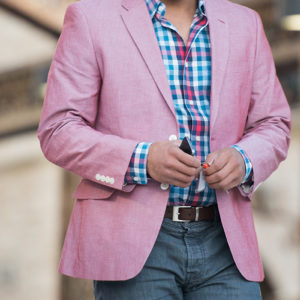 Man-Wearing-Casual-Pink-Jacket-And-Smartphone-Walking
