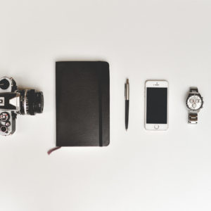 Retro-Film-Camera,-Notebook,-Pen,-Smartphone-and-Watch